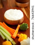 Tzatziki a cool and cream dip accompanied by vegetables - stock photo