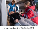 paramedics moving wounded... | Shutterstock . vector #766454221