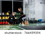 the young girl does the squat... | Shutterstock . vector #766459354