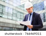 professional man in jacket and... | Shutterstock . vector #766469311