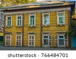 a two storey yellow dwelling... | Shutterstock . vector #766484701