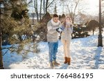 happy couple blowing snow in... | Shutterstock . vector #766486195