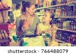 female and child choosing fresh ... | Shutterstock . vector #766488079