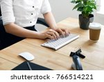 work. woman hands typing on... | Shutterstock . vector #766514221