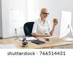 work. woman working on computer ... | Shutterstock . vector #766514431