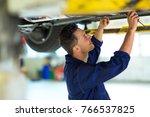 car mechanic in workshop   Shutterstock . vector #766537825