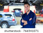 mechanic working on car in auto ... | Shutterstock . vector #766541071