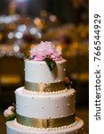 wedding cake at reception | Shutterstock . vector #766544929