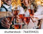 friends celebrating christmas... | Shutterstock . vector #766554421