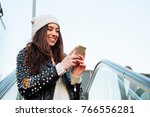 happy and beautiful young woman ... | Shutterstock . vector #766556281
