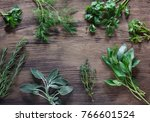 fresh herbs on wooden... | Shutterstock . vector #766601524