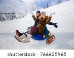 happy lovers people on sled... | Shutterstock . vector #766625965