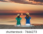Sunset On The Sea With Two Women