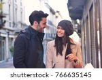 a couple of young engaged or... | Shutterstock . vector #766635145