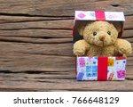 Cute Teddy Bear In Gift Box On...