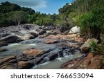 a steep river flowing over... | Shutterstock . vector #766653094