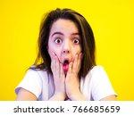 portrait of surprised girl... | Shutterstock . vector #766685659