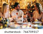 friends celebrating christmas... | Shutterstock . vector #766709317