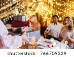 friends celebrating christmas... | Shutterstock . vector #766709329