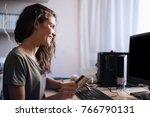 happy woman buying online | Shutterstock . vector #766790131