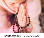 concentrated woman praying... | Shutterstock . vector #766793629