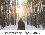 Woman Walks A Winter Forest...