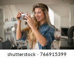 indoor smiling lifestyle... | Shutterstock . vector #766915399