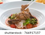 rice noodles with spicy pork... | Shutterstock . vector #766917157