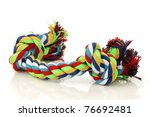 Stock photo colorful cotton dog toy on a white background 76692481