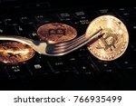 golden bitcoins with fork. hard ... | Shutterstock . vector #766935499