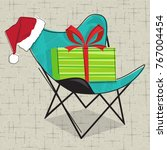 butterfly chair with santa hat... | Shutterstock .eps vector #767004454