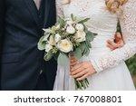 groom in suit and bride in... | Shutterstock . vector #767008801