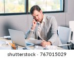 a male office worker talking on ... | Shutterstock . vector #767015029