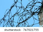 tangle of barbed wire to...