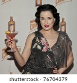 NEW YORK - MAY 05: Dita Von Teese attends launch of her new signature cocktail 'The Cointreau MargaDita' at Los Feliz restaurant on May 05, 2011 in New York City, NY - stock photo