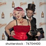 NEW YORK - MAY 05: Burlesque artists Dirty Martini and guest attend launch of Dita Von Teese new signature cocktail 'The Cointreau MargaDita' at Los Feliz restaurant on May 05, 2011 in New York City, NY - stock photo