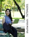 happy working woman holding... | Shutterstock . vector #767046301