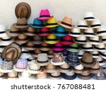 A Stack Of Straw Colored  Hats...