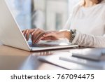 woman typing on her laptop | Shutterstock . vector #767094475