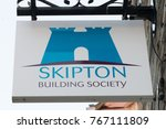 Small photo of Keswick,UK - 30th November 2017:Hanging sihnboard of the Skipton Building society. The mutual society provides a service to rural banking customers