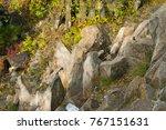 group of rocks in park.... | Shutterstock . vector #767151631