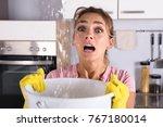 worried woman holding a bucket...   Shutterstock . vector #767180014