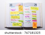 high angle view of open diary... | Shutterstock . vector #767181325