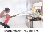 young african woman using fire... | Shutterstock . vector #767181475