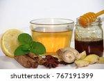 Small photo of healthy tea of ginger mint lemon cinnamon curcuma anis and honey