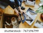 woman unboxing unpacking... | Shutterstock . vector #767196799