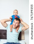 handsome father holding on... | Shutterstock . vector #767199355