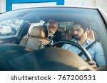Small photo of Senior business man sitting in his limousine. Business concept.