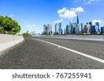 asphalt road and modern city... | Shutterstock . vector #767255941