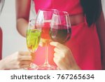glasses with cocktails held by... | Shutterstock . vector #767265634